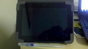My Kindle HD shown with a pen for sizing